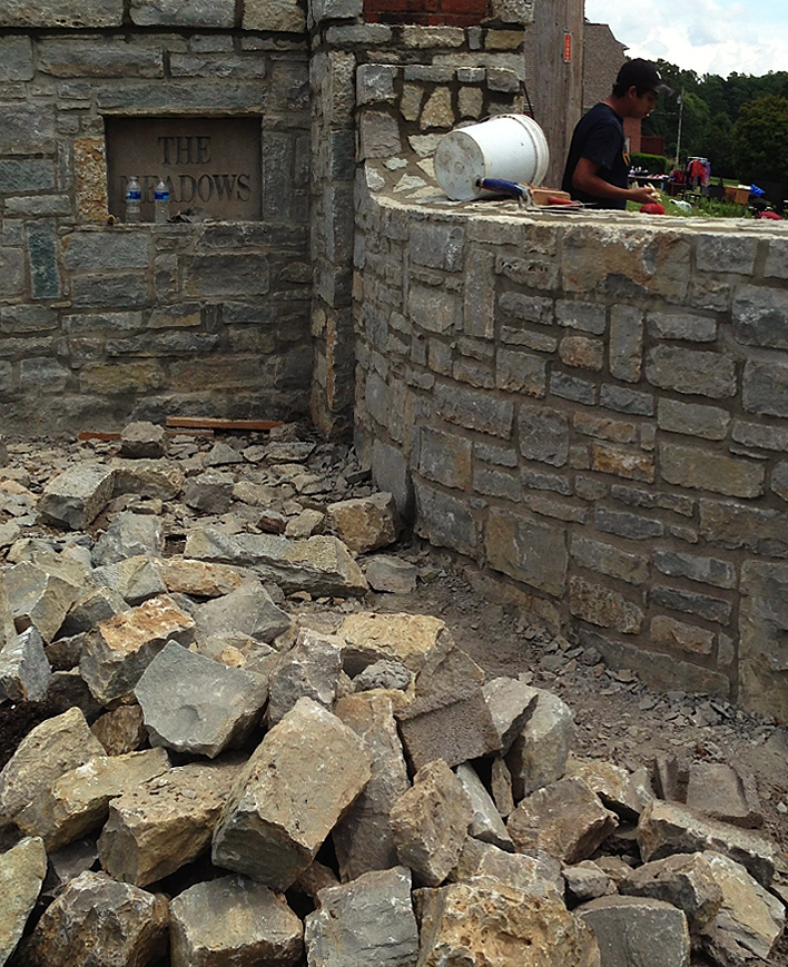The Meadows' stone wall entrance under construction