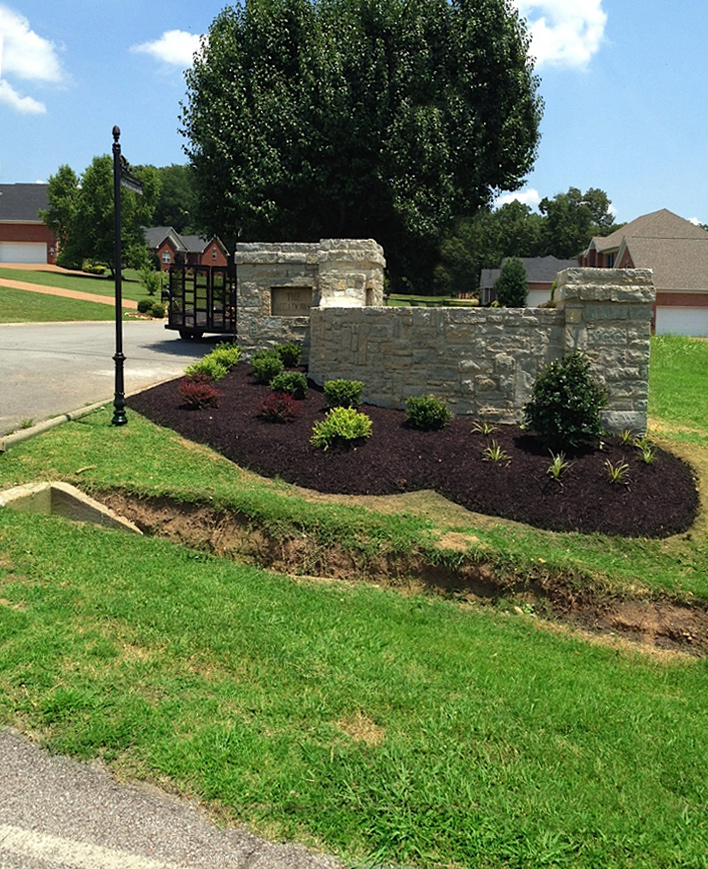 The Meadows' stone wall entrance completion