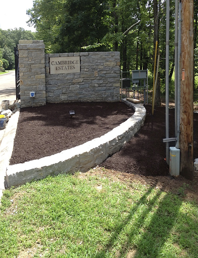 Cambridge Estate's stone wall entrance, retaining wall & terraced landscaping