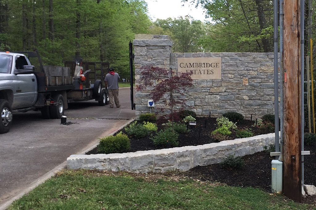 Completed Cambridge Estate's stone wall entrance, retaining wall & terraced landscaping